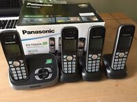 Panasonic quad pack cordless phones with answering machine.