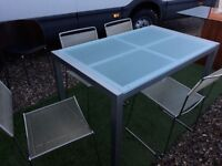 Glass top table with 4 chairs - used