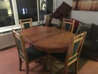 Extendable round table and 4 chairs