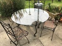 Glass Top Metal Table and 4 Metal Lattice Design Chairs