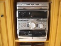 GREAT SONY STEREO SYSTEM WITH SPEAKERS AND STANDS. 3 CD, 2 CASSETTE , RADIO ETC. GRE AT SOUND