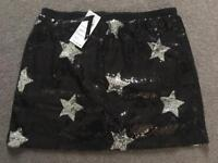 New ladies black & silver sequin skirt 10-12.