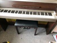 Yamaha piano with stool