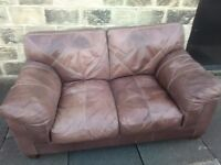 quality 2 seater brown leather sofa. Free delivery