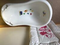 Winnie the poo baby bathtub with changing mat used