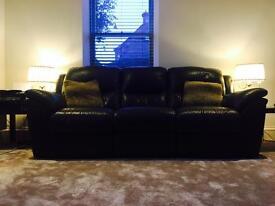 Dark brown electric recliner sofa.