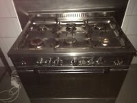 6 BURNER GAS RANGE WITH OVEN. USED BUT IN GOOD CONDITION