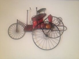 Wall art of Victorian Tricycle Made from metal & painted in bright metalic colours.
