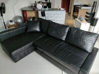 Corner sofa-bed with storage Ikea FRIHETEN Bomstad black