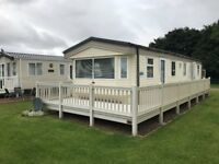 Cheap double glazed and gas central heated 3 bedroom static caravan for sale with full UPVC decking