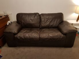 2 x Brown 2 seater leather sofas and storage footstool
