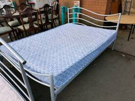 Waved metal double bed frame with mattress