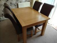 Extendable oak table and 4 leather chairs