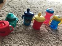 Variety of Sippy cups and Bottles