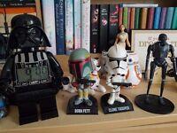 star wars collectables including darth vader lego clock.
