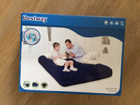 Inflatable double air mattress - brand new! W/ electrical pump.