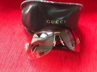 Genuine Gucci sun glasses with case and a cloth