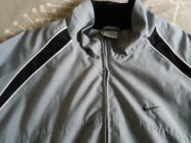 Nike mens grey jacket size XL. Worn once.
