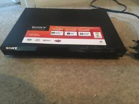 Sony DVD player with remote and 10 dvds