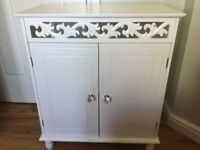 Beautiful white cupboard with crystal knobs