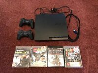 PS3 with games and 2 controllers and HMDI wire