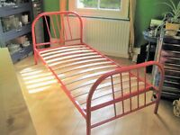 Childrens red metal bed frame in very good condition