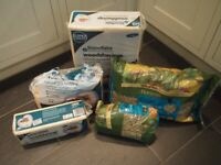 Large bundle of pet bedding wood shavings and Burgess Excell feeding hay