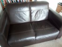 Two seater brown leather sofa for sale