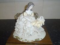 perfect china figure lady holding a baby