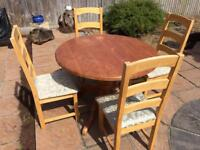 Solid pine round dining table and 4 dining chairs. This is an up-cycling project