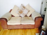 Two 2 seater matching sofas. Removable covers, pillows included.