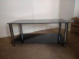 Black glass coffee table with shelf