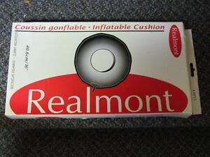 NEW, Realmont Inflatable Cushion.