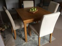 Oak Dining table (extendable) and 4 chairs for sale
