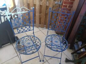 Pair of blue metal chairs