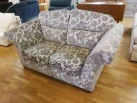 Floral patterned fabric 2 seater sofa