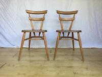 Pair of vintage Ercol adult green dot stacking dining chairs