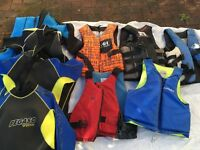 5 life preservers & 4 wetsuits
