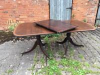 Mahogany dining table and 6 chairs for sale.