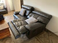 Brown leather reclining electric sofa