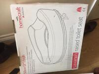Plastic Toilet seat raiser new and boxed - disabled aid