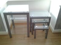 Furniture one tall table and a matching nest of three tables in silver and glass