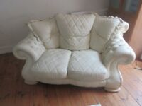 CREAM LEATHER SOFA, ARMCHAIR AND MATCHING FOOTSTOOL. COLLECTION FROM ST MARKS, CHELTENHAM
