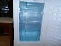 Frost Free white Swan fridge freezer. Godd condition inside but a few scratches on the side panels