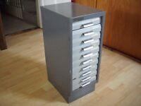 Set of 10 metal drawers in Myers Kingsbury metal cabinet.