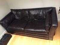 Dark two seater sofa