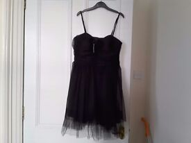 Lacy black party dress size 12 brand new with labels on