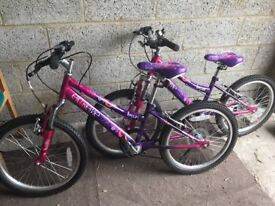 Girls Bicycles with baskets and helmets