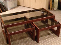 Glass-topped mahogany coffee table and small matching tables