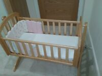 Wooden crib with mattress and bumper
